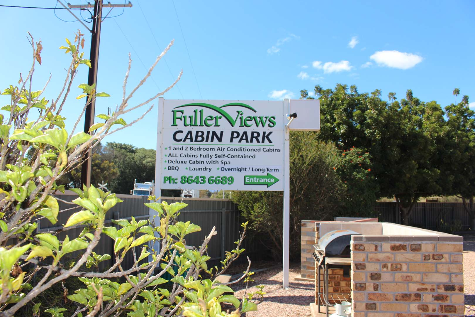 fuller-views-cabin-park-large-sign-plant