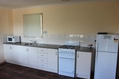 fuller-views-cabin-park-kitchen-fridge-stove-microwave